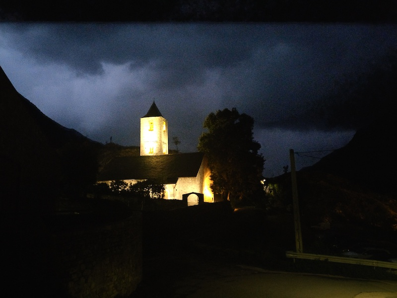 Sant Joan de Boí at night with lightning in the background